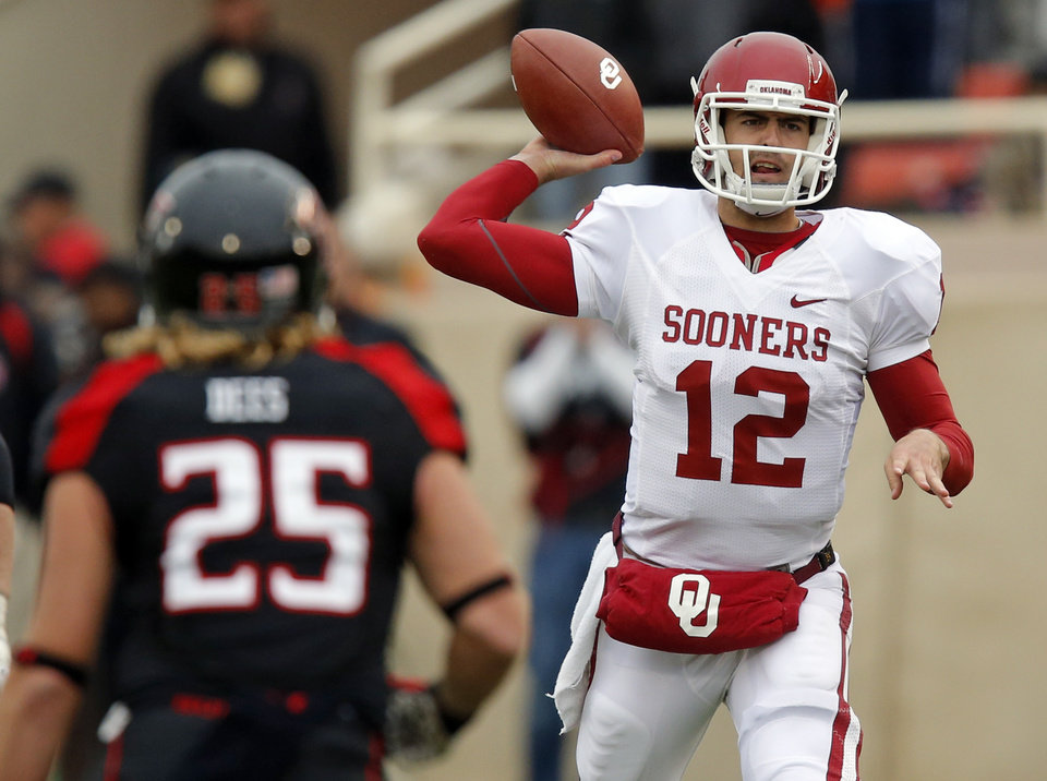 Photo - Oklahoma's Landry Jones (12) passes  during a college football game between the University of Oklahoma (OU) and Texas Tech University at Jones AT&T Stadium in Lubbock, Texas, Saturday, Oct. 6, 2012. OU won, 41-20. Photo by Nate Billings, The Oklahoman