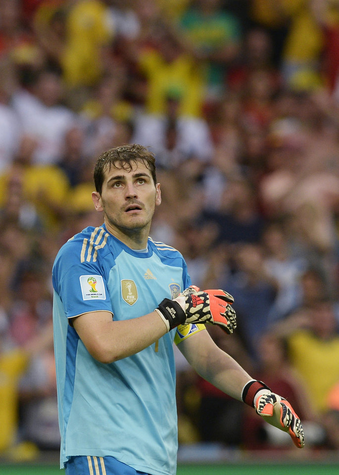 Photo - Spain's goalkeeper Iker Casillas looks up after conceding a goal during the group B World Cup soccer match between Spain and Chile at the Maracana Stadium in Rio de Janeiro, Brazil, Wednesday, June 18, 2014.  (AP Photo/Manu Fernandez)