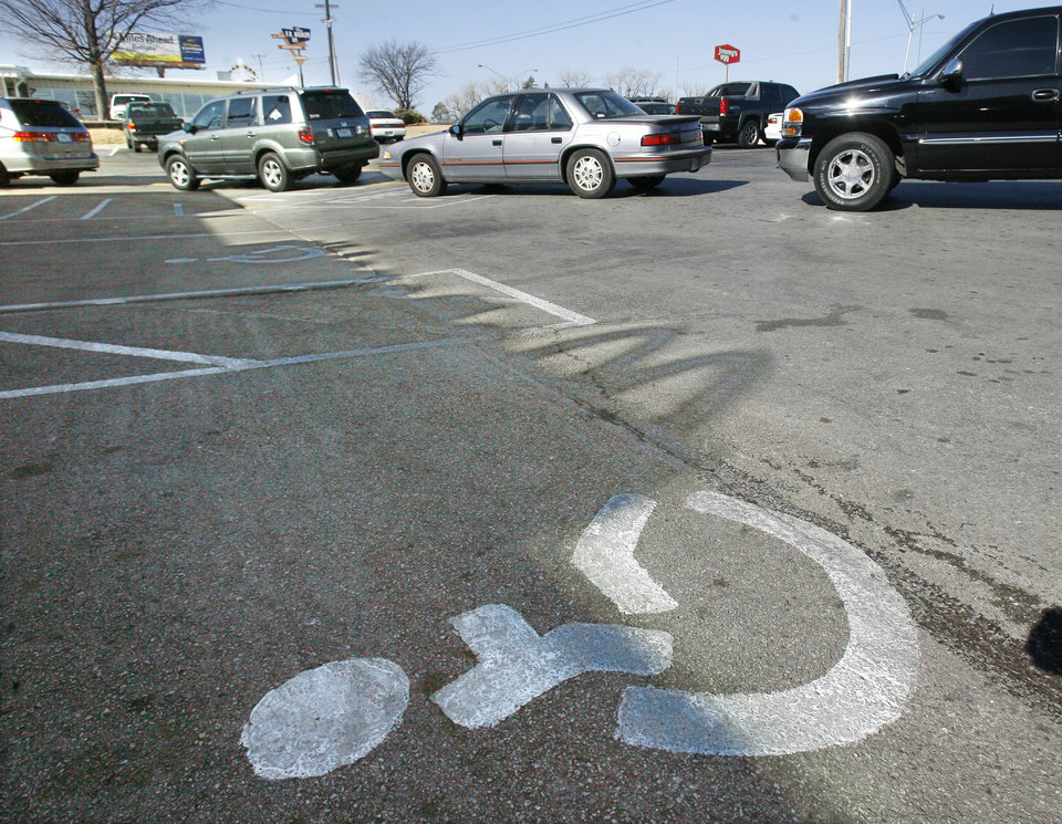 Photo - Motorists in the drive-through lane block entry to handicapped parking spaces at the McDonalds at 39th and Portland in Oklahoma City, OK, Friday, Jan. 16, 2009. BY PAUL HELLSTERN, THE OKLAHOMAN