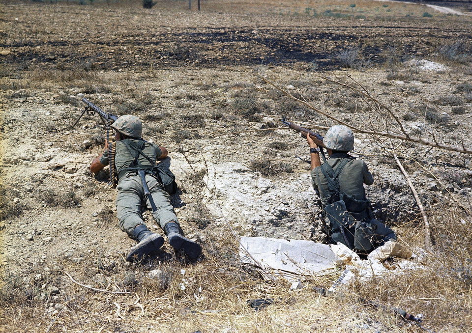 Photo - FILE - In this file photo dated July 25, 1974, Turkish troops in position on the frontline some 500 yards form the outer perimeter and 400 yards from Greek position at the Nicosia Airport, Cyprus.  Europe's top human rights court on Monday May 12, 2014, ordered Turkey to pay 90 million euros ($123 million) to Cyprus over the 1974 invasion of the island and its subsequent division, in one of the largest judgments in its history, saying that the passage of time did not erase responsibility in the case. The judgment comes as the Turkish and Greek Cypriot communities are engaged in renewed efforts to reunite the island. (AP Photo/Max Nash, FILE)