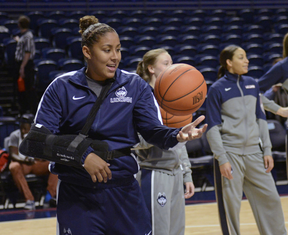 Photo - Sidelined by an injury, Connecticut's Kaleena Mosqueda-Lewis (23) catches balls for teammates before an NCAA college basketball game against Penn State, Sunday, Nov. 17, 2013, in State College, Pa. (AP Photo/John Beale)