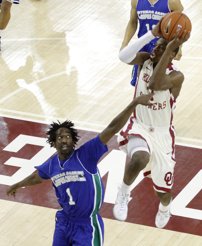 Photo - OU: Oklahoma's Buddy Hield (3) takes a shot over Texas A&M's Hameed Ali (1) during a college basketball game between the University of Oklahoma and Texas A&M Corpus Christi at McCasland Field House in Norman, Okla., Monday, Dec. 31, 2012.  Photo by Garett Fisbeck, For The Oklahoman