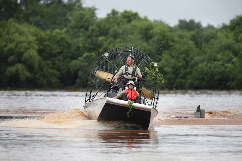 Oklahoma Highway Patrol use an air boat near Hefner road and Sooner road to search for motorist stranded in high water in Oklahoma City, Oklahoma June 14 , 2010. Photo by Steve Gooch, The Oklahoman