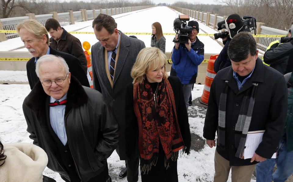 Photo - Governor Mary Fallin tours the U.S. 77/SH39 bridge between Purcell and Lexington and announces plans to repair it on Friday, Feb. 7, 2014 in Lexington, Okla.  Others from left are J. Michael Patterson, Transportation Department Director, Representative Bobby Cleveland, Senator John Sparks, and Engineer Casey Shell.  Photo by Steve Sisney, The Oklahoman