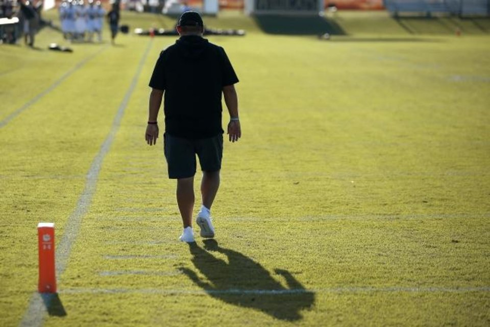 Photo -  Cashion assistant coach Cale Cochran walks down the sideline before the Wildcats played Perry earlier this season. Cochran's wife, Jacie, died over the summer during childbirth. [Bryan Terry/The Oklahoman]