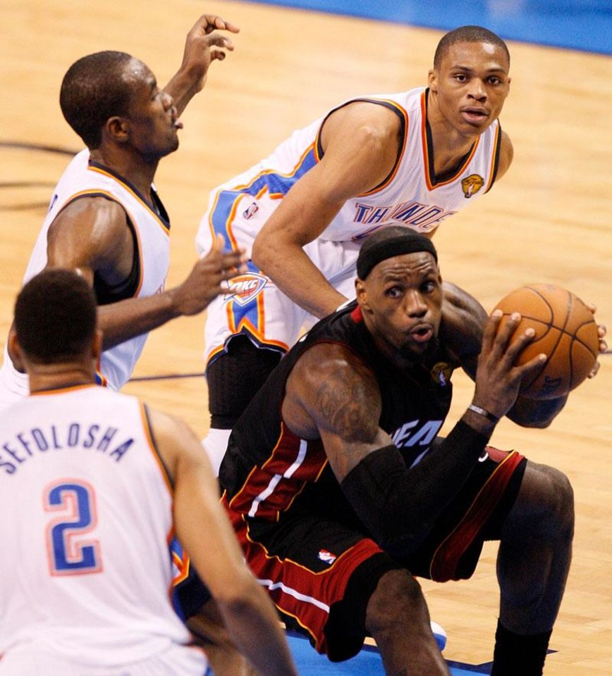 Photo -  Miami's LeBron James (6) works the ball between, from lower left, Oklahoma City's Thabo Sefolosha (2), Serge Ibaka (9) and Russell Westbrook (0) during Game 2 of the NBA Finals between the Oklahoma City Thunder and the Miami Heat at Chesapeake Energy Arena in Oklahoma City, Thursday, June 14, 2012. Photo by Nate Billings, The Oklahoman