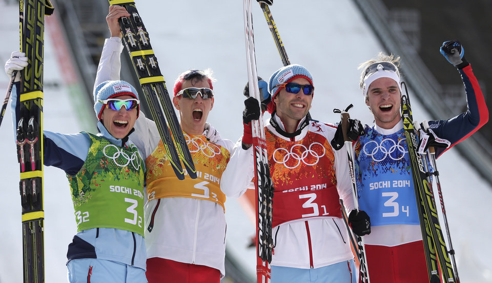 Photo - Norway's Haavard Klemetsen, Magnus Krog, Magnus Hovdal Moan and Joergen Graabak, from left, celebrate winning the gold during the cross-country portion of the Nordic combined Gundersen large hill team competition at the 2014 Winter Olympics, Thursday, Feb. 20, 2014, in Krasnaya Polyana, Russia. (AP Photo/Matthias Schrader)
