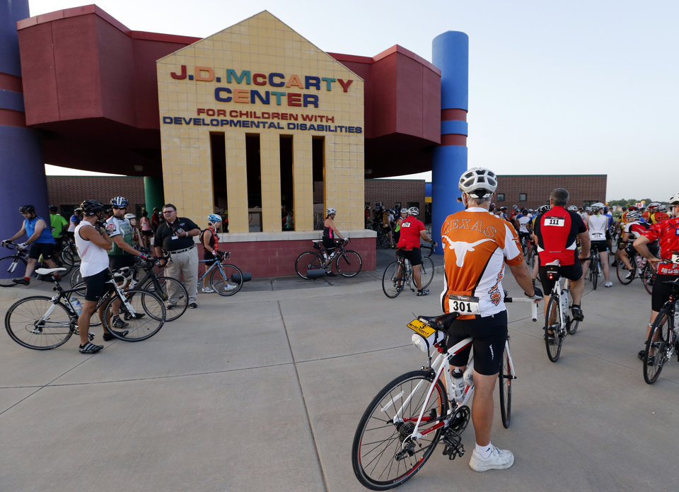 Photo -  Riders line up for the start of the Norman Conquest bike ride that benefits the J.D. McCarty Center. PHOTO BY STEVE SISNEY, THE OKLAHOMAN   STEVE SISNEY