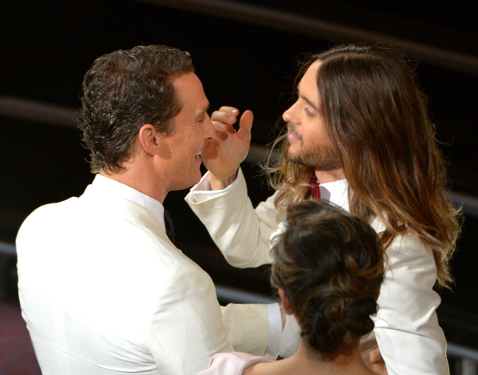Photo - Matthew McConaughey, left, congratulates Jared Leto in the audience during the Oscars at the Dolby Theatre on Sunday, March 2, 2014, in Los Angeles.  (Photo by John Shearer/Invision/AP)