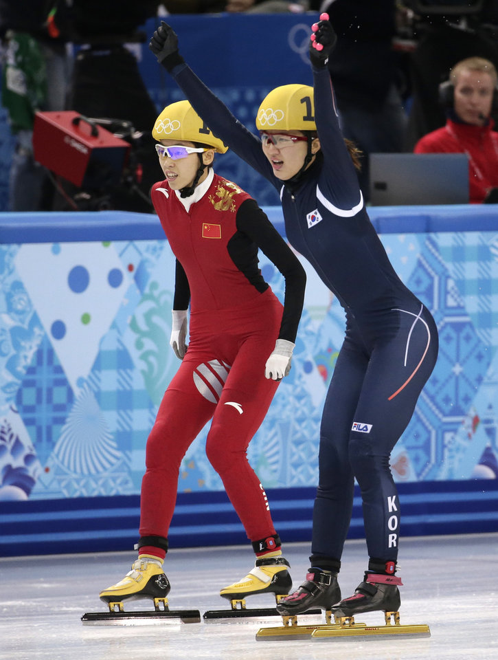Photo - Park Seung-hi of South Korea, right, crosses the finish line to win ahead of Fan Kexin of China in the women's 1000m short track speedskating final at the Iceberg Skating Palace during the 2014 Winter Olympics, Friday, Feb. 21, 2014, in Sochi, Russia. (AP Photo/Bernat Armangue)