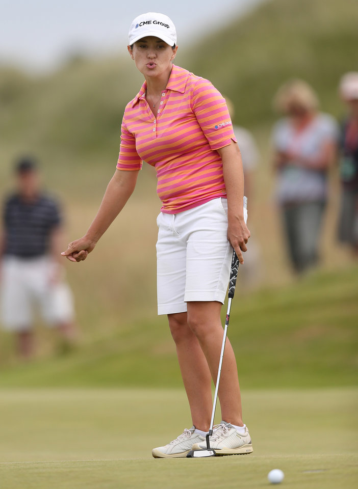 Photo - Mo Martin of the US putts on the 11th green during the third day of the Women's British Open golf championship, at the Royal Birkdale Golf Club, in Southport, England, Saturday, July 12, 2014. (AP Photo/Scott Heppell)