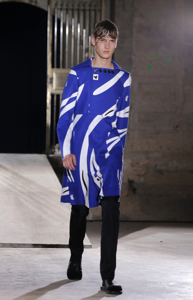 Photo - A model wears a creation by Belgian fashion designer Raf Simons, for his men's Spring-Summer 2015 collection, presented in Paris, Wednesday, June 25, 2014. (AP Photo/Jacques Brinon)