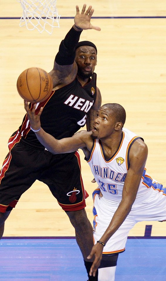 Photo - ALTERNATE CROP: Oklahoma City's Kevin Durant (35) takes a shot against Miami's LeBron James (6) during Game 2 of the NBA Finals between the Oklahoma City Thunder and the Miami Heat at Chesapeake Energy Arena in Oklahoma City, Thursday, June 14, 2012. Miami won, 100-96. Photo by Nate Billings, The Oklahoman