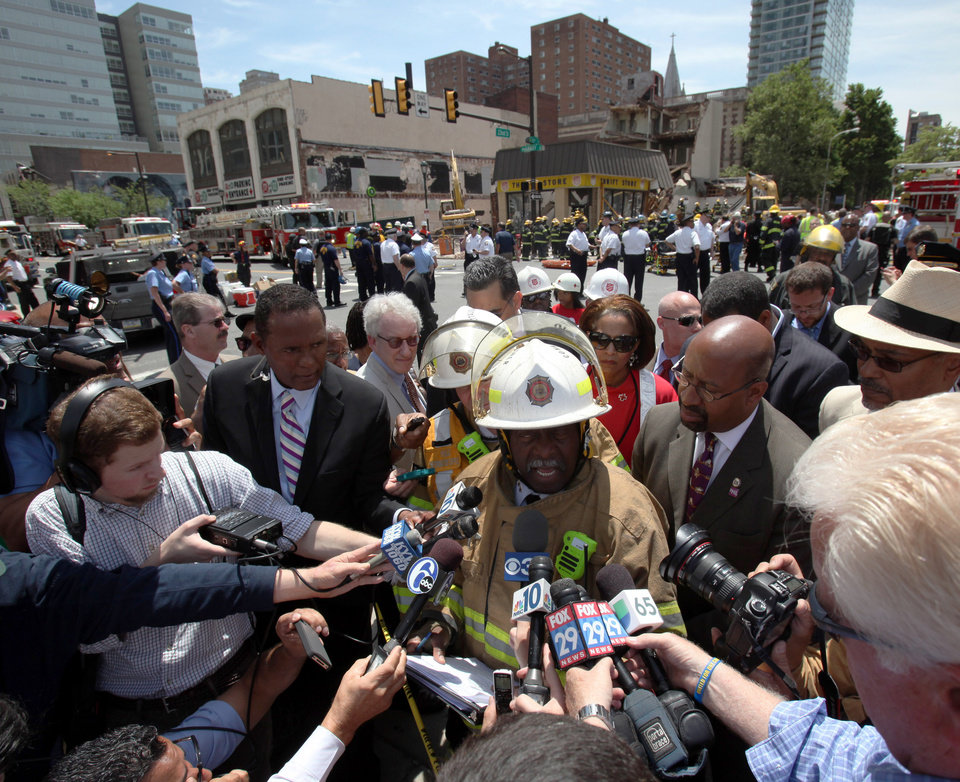 Photo - Philadelphia Fire Commissioner Lloyd Ayers addresses the media alongside Mayor Michael Nutter, left, at the scene of a building collapse in downtown Philadelphia Wednesday June 5, 2013.  A four-story building being demolished collapsed Wednesday on the edge of downtown, injuring 12 people and trapping two others, the fire commissioner said.  (AP Photo/Jacqueline Larma)