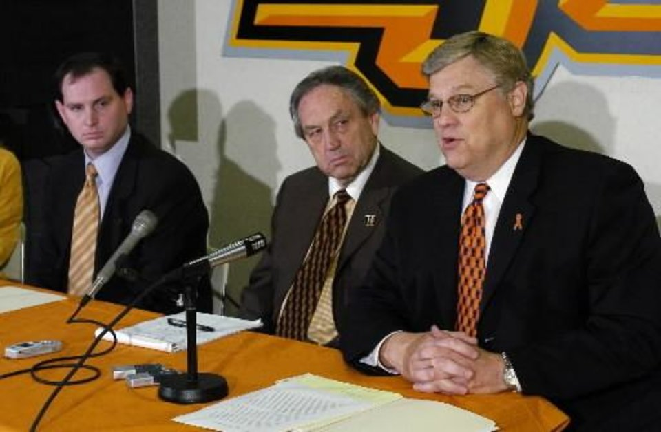 Photo - Sean Sutton, Eddie Sutton, and athletic director Harry Birdwell appear at a press conference announcing Sean Sutton as college basketball head coach designate at Oklahoma State University in this 2004 photo by Steve Sisney.