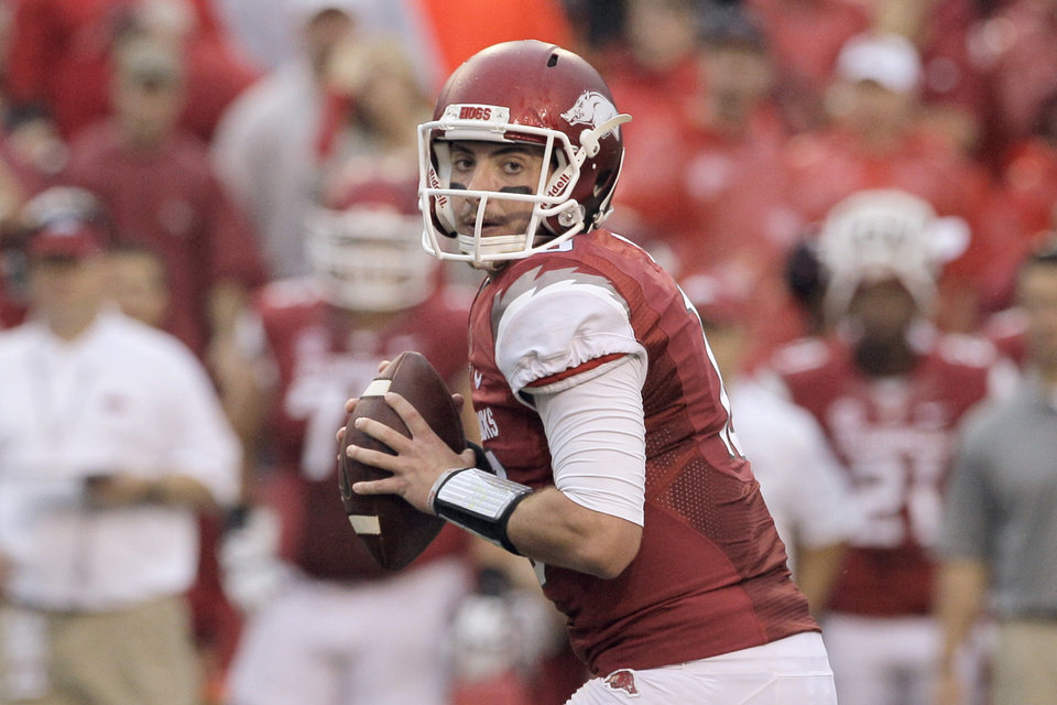 Photo - FILE - In this file photo taken Sept. 28, 2013, Arkansas quarterback Brandon Allen prepares to pass during the first quarter of an NCAA college football game against Texas A&M in Fayetteville, Ark. Much of Arkansas' hopes this season depend on the expected improvement of quarterback Allen. (AP Photo/Danny Johnston, File)