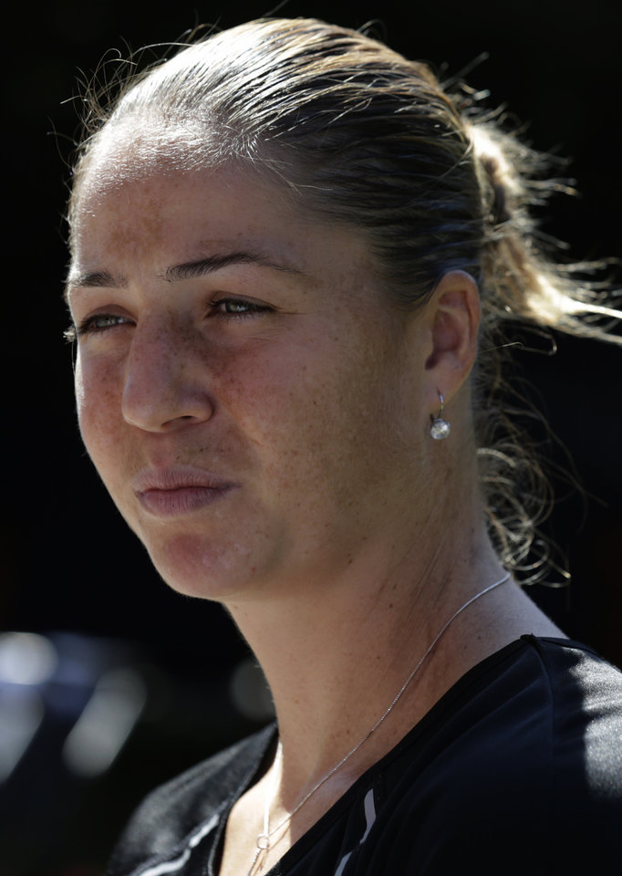 Photo - Alisa Kleybanova speaks to the media a day before the US Open tennis tournament starts, Sunday, Aug. 25, 2013, in New York. Kleybanova, a former top-20 player, is recovering from cancer. (AP Photo/Charles Krupa)