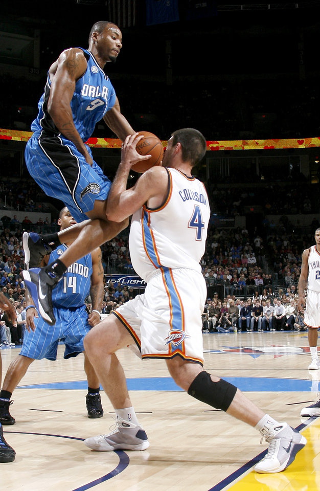Photo - Orlando's Rashard Lewis defends Oklahoma City's Nick Collison during the NBA basketball game between the Oklahoma City Thunder and the Orlando Magic at the Ford Center in Oklahoma City, Wednesday, Nov. 12, 2008. BY BRYAN TERRY, THE OKLAHOMAN   ORG XMIT: KOD