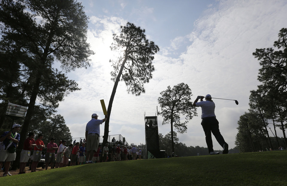 Photo - Brendon De Jonge, of Zimbabwe, watches his tee shot on the eighth hole during the second round of the U.S. Open golf tournament in Pinehurst, N.C., Friday, June 13, 2014. (AP Photo/Eric Gay)