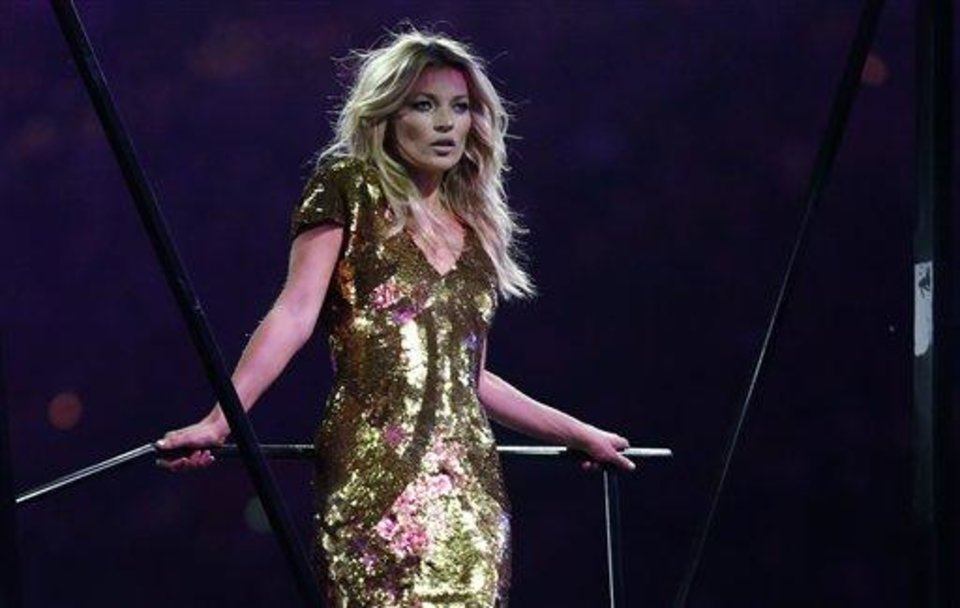 Photo - British model Kate Moss poses on stage during the Closing Ceremony at the 2012 Summer Olympics, Sunday, Aug. 12, 2012, in London. (AP Photo/Matt Dunham)