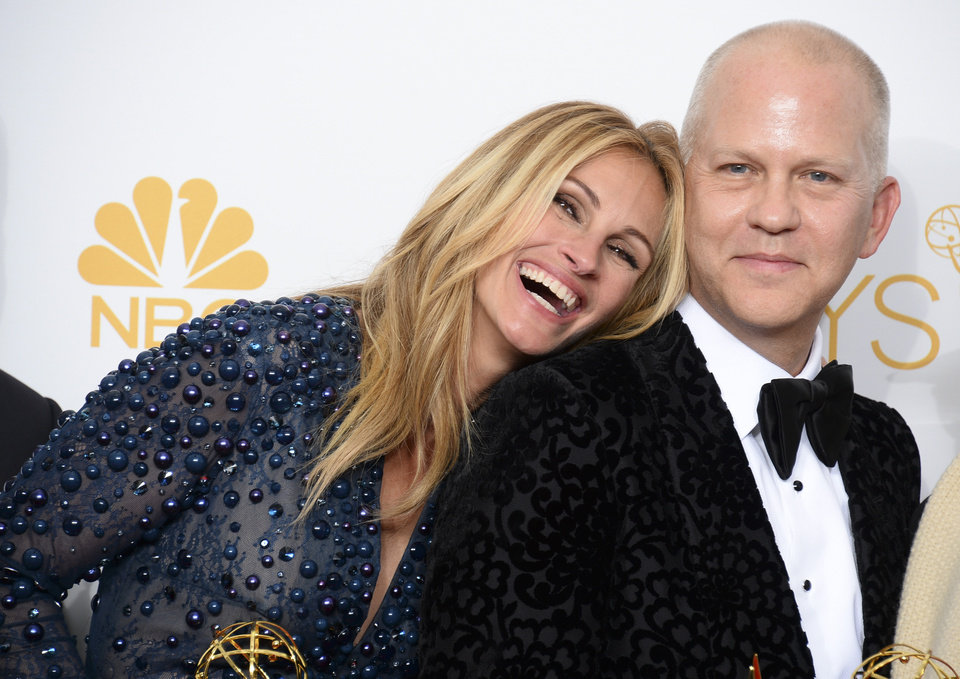 Photo - Julia Roberts, left, and Ryan Murphy pose in the press room at the 66th Annual Primetime Emmy Awards at the Nokia Theatre L.A. Live on Monday, Aug. 25, 2014, in Los Angeles. (Photo by Jordan Strauss/Invision/AP)