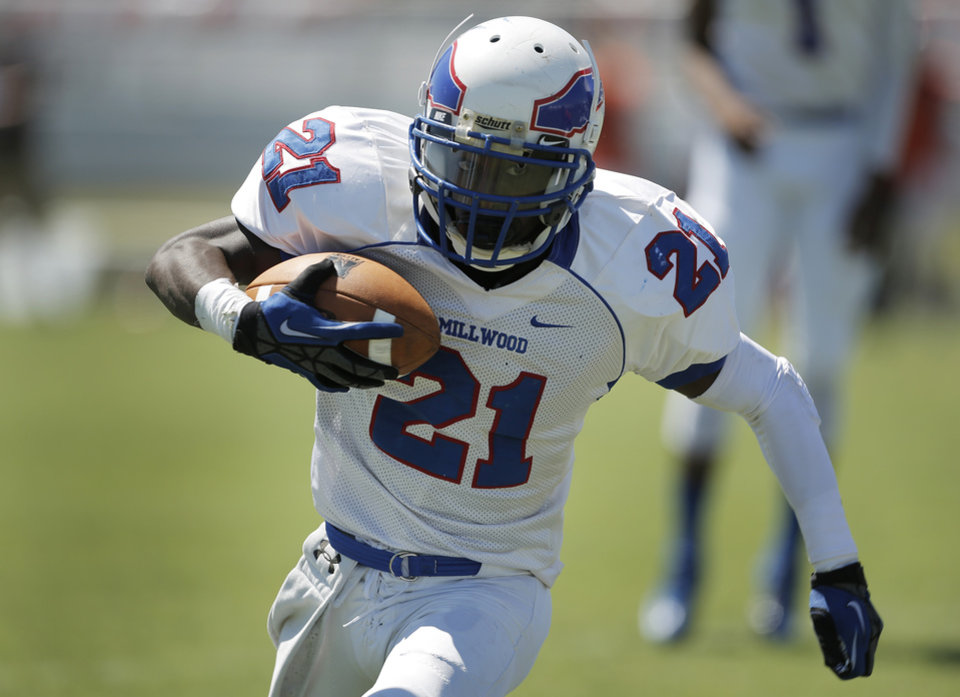 Millwood's Janari Glover (21) runs th ball during a high school football game between Douglass and Millwood in Oklahoma City, Saturday, Sept. 8, 2012.  Photo by Garett Fisbeck, The Oklahoman