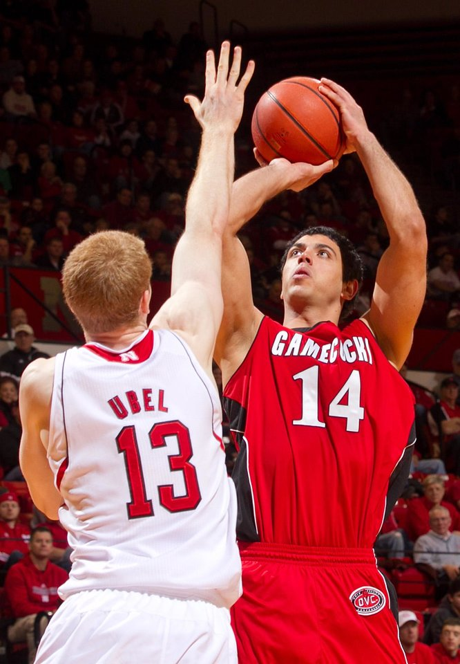 Photo - Jacksonville State's Rinaldo Mafra (14) sinks a shot over Nebraska's Brandon Ubel (13) during the first half of an NCAA college basketball game Tuesday, Dec. 18, 2012, in Lincoln, Neb. Nebraska defeated Jacksonville State 59-55. (AP Photo/The Omaha World-Herald, Mark Davis) MAGS OUT  LOCAL TV OUT