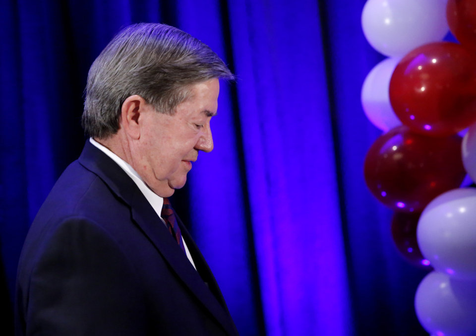 Photo - Drew Edmondson walks to the podium to give a concession speech after losing the governor's race to Republican Kevin Stitt during a watch party for Drew Edmondson and the democratic party at the Embassy Suites  in Oklahoma City, Tuesday, Nov. 6, 2018. Photo by Sarah Phipps, The Oklahoman