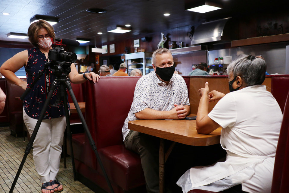 Photo - The Oklahoman's videographer Paige Dillard, left, and food editor Dave Cathey, center, interview Rosie Parker, who perfected the secret salad dressing recipe for Cattlemen's Steakhouse. [Doug Hoke/The Oklahoman]