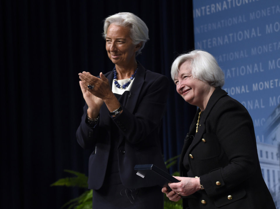 Photo - International Monetary Fund (IMF) Managing Director Christine Lagarde applauds Federal Reserve Chair Janet Yellen following a conversation at the IMF in Washington, Wednesday, July 2, 2014. Yellen said she doesn't see a need for the Fed to start raising interest rates to address the risk that extremely low rates could destabilize the financial system.  (AP Photo/Susan Walsh)
