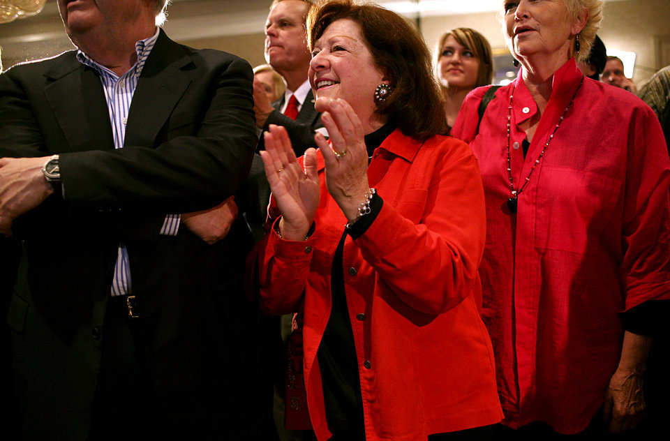 Photo - Deloris Bradford (center) celebrates as she watches election results from around the country on the television during the Republican Watch Party at the Marriott in Oklahoma City on Tuesday, Nov. 2, 2010.Photo by John Clanton, The Oklahoman