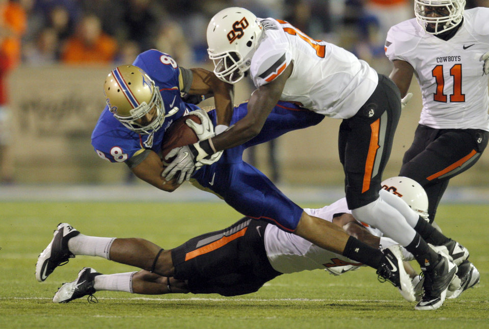 Photo - Oklahoma State's Markelle Martin (10)tackles Tulsa's Bryan Burnham (88)during a college football game between the Oklahoma State University Cowboys and the University of Tulsa Golden Hurricane at H.A. Chapman Stadium in Tulsa, Okla., Sunday, Sept. 18, 2011. Photo by Sarah Phipps, The Oklahoman