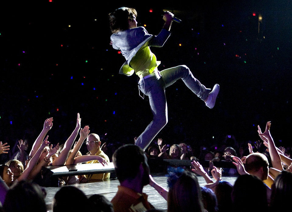 Joe Jonas, with The Jonas Brothers, performs at the Ford Center in Oklahoma City, Tuesday, July 8, 2008. BY BRYAN TERRY, THE OKLAHOMAN