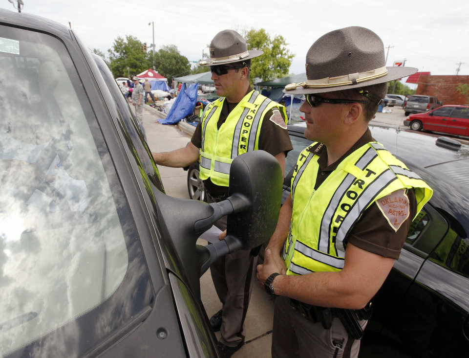 Highway Patrol troopers Randall Milan, left, and Gabe Leach work perimeter security on the north side of the tornado devestated part of Moore, OK, Thursday, May 23, 2013,  Photo by Paul Hellstern, The Oklahoman