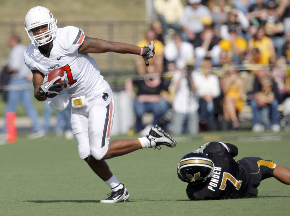 Photo - Oklahoma State's Tracy Moore (87) gets by Missouri's Randy Ponder (7) during a college football game between the Oklahoma State University Cowboys (OSU) and the University of Missouri Tigers (Mizzou) at Faurot Field in Columbia, Mo., Saturday, Oct. 22, 2011. Photo by Sarah Phipps, The Oklahoman