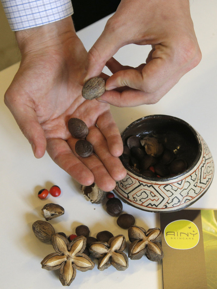 Photo -   Nuts of Sacha Inchi plant from Amazonia in Daniel Joutard's hands, director and founder of Ainy, during an interview with the Associated Press in Paris, Thursday, Sept, 13, 2012. Joutard wants to hire more employees for his growing, innovative skin-care products company, but can't take the risk in large part because of France's inflexible workplace protections. The 37-year-old is among thousands of small- and medium-size business owners who will be crucial to help France _ like other countries in Europe _ reduce a double-digit jobless rate, and ultimately shrink its hefty state budget deficit by bringing in more tax revenues. (AP Photo/Francois Mori)