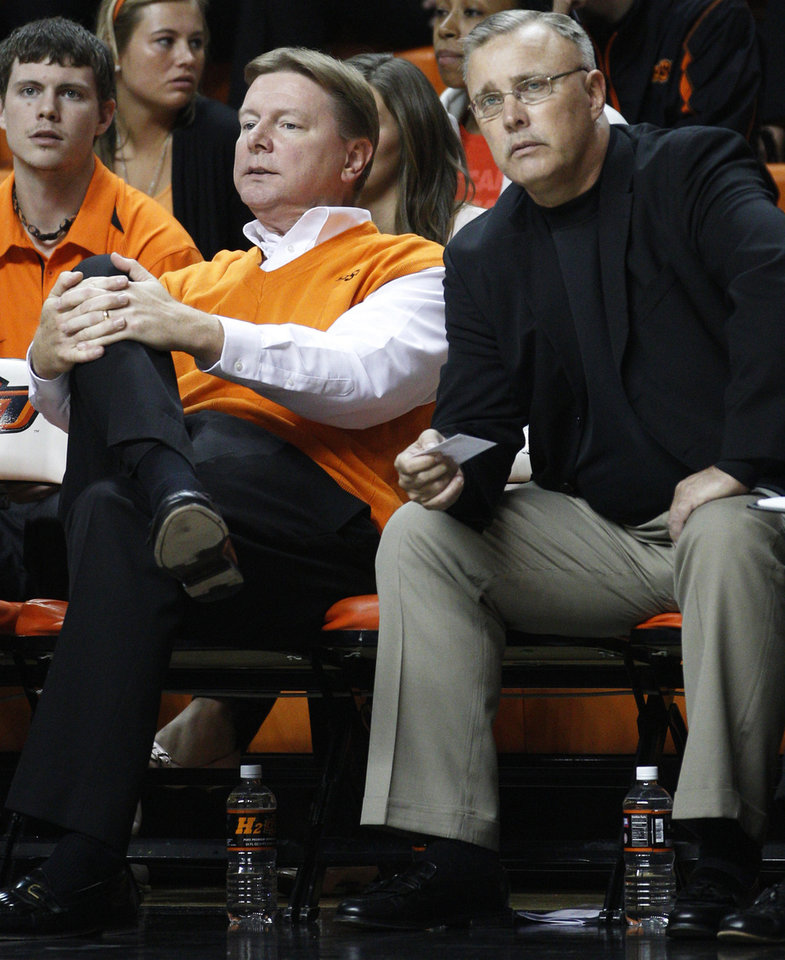 OSU women's coach Jim Littell, right, took over for Kurt Budke, left, after Budke and assistant coach Miranda Serna were killed in a plane crash Nov. 17, 2011. AP Photo