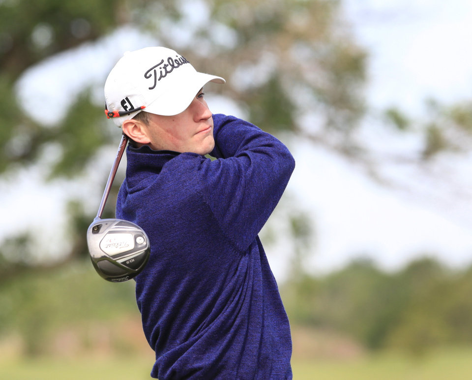Photo - Cole Goekeler, Cascia Hall, tees off in the Class 4A boys golf at Lake Hefner Golf Course, Tuesday May 13, 2014.  Photo by David McDaniel, The Oklahoman
