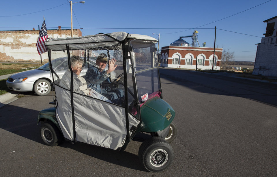 Donald Teten, 78, and his wife Kathy, head home in their golf cart after voting in the small village of Talmage, Neb., Tuesday, Nov. 6, 2012. (AP Photo/Nati Harnik)
