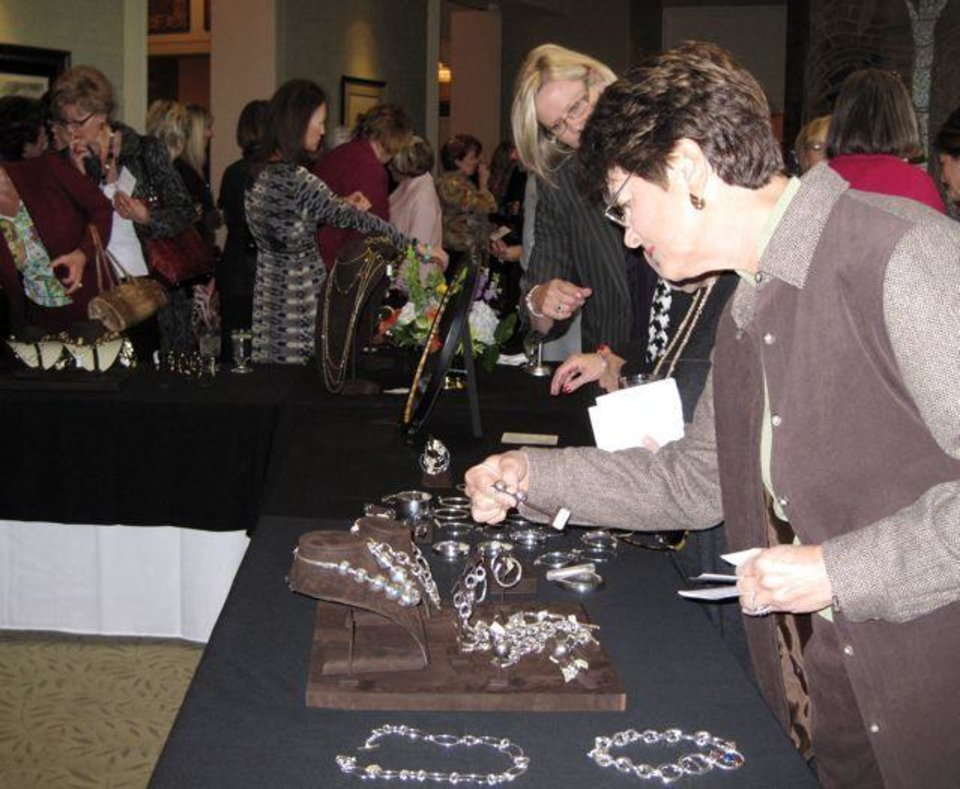 Heart Rhythm Institute..Guests check out the jewelry. (Photo by Helen Ford Wallace).