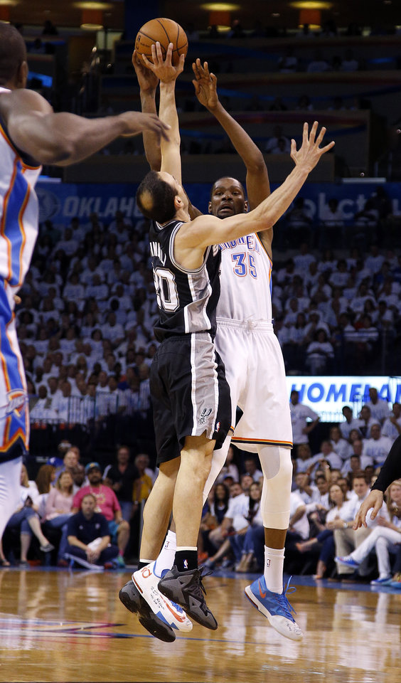 Photo - Oklahoma City's Kevin Durant (35) shoots over San Antonio's Manu Ginobili (20) during Game 6 of the Western Conference Finals in the NBA playoffs between the Oklahoma City Thunder and the San Antonio Spurs at Chesapeake Energy Arena in Oklahoma City, Saturday, May 31, 2014. Photo by Bryan Terry, The Oklahoman