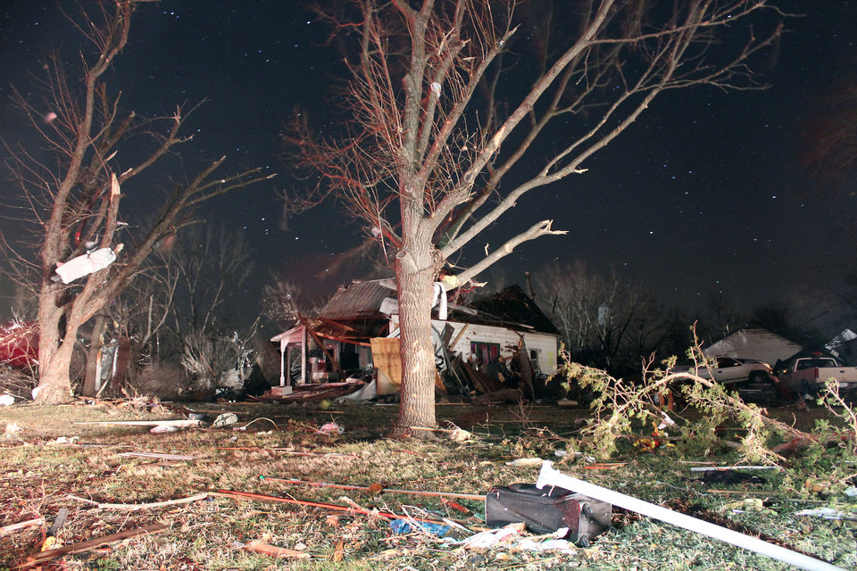 Damage is seen early Wednesday morning Feb. 29, 2012 in the town of Harveyville in Wabaunsee County Kansas after an apparent tornado passed through the town Tuesday night. Kansas Gov. Sam Brownback declared a state of emergency late Tuesday after an apparent tornado struck Harveyville, part of a powerful storm system that pounded the state's midsection. (AP Photo/Matthew Fowler, Gazette) ORG XMIT: KSEMP102