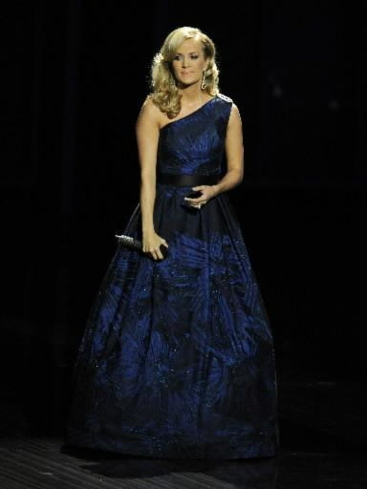 "Photo -  Carrie Underwood performs ""Yesterday"" by The Beatles at the 65th Primetime Emmy Awards at Nokia Theatre on Sunday Sept. 22, 2013, in Los Angeles. (AP)"