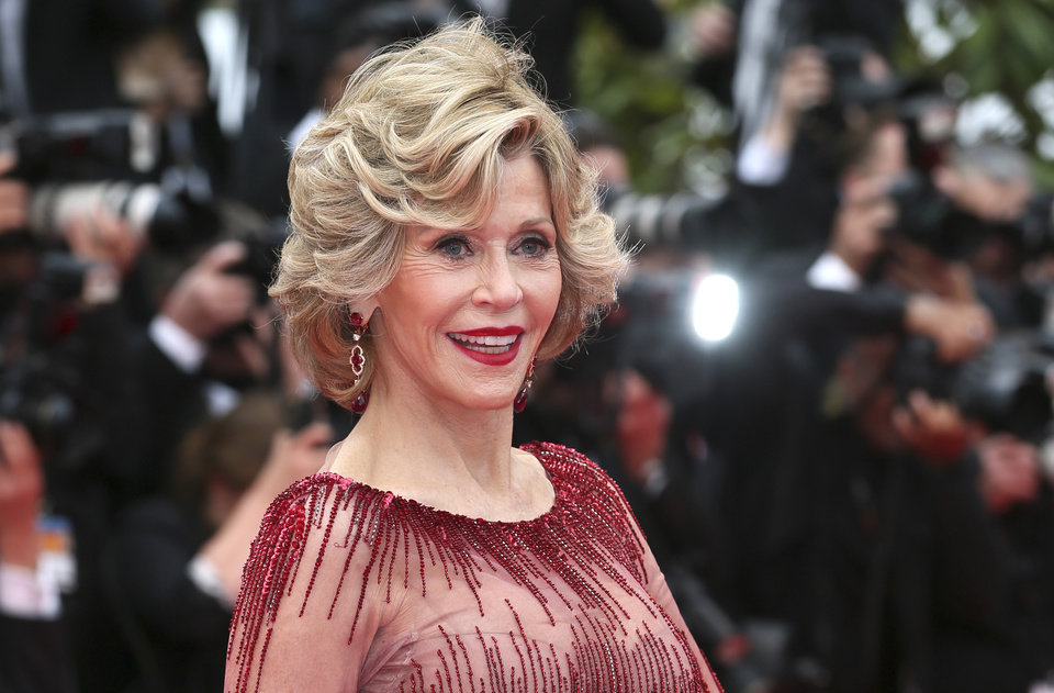 Photo - FILE - In this May 14, 2014 file photo, American actress Jane Fonda poses for photographers during the opening ceremony and the screening of
