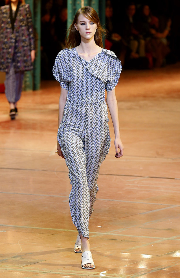 A model wears a a creation by fashion designers Humberto Leon, from Peru, and Carol Lim, from South Korea for Kenzo Ready to Wear Fall-Winter 2013-2014 fashion collection, presented, Sunday, March 3, 2013 in Paris. (AP Photo/Jacques Brinon)