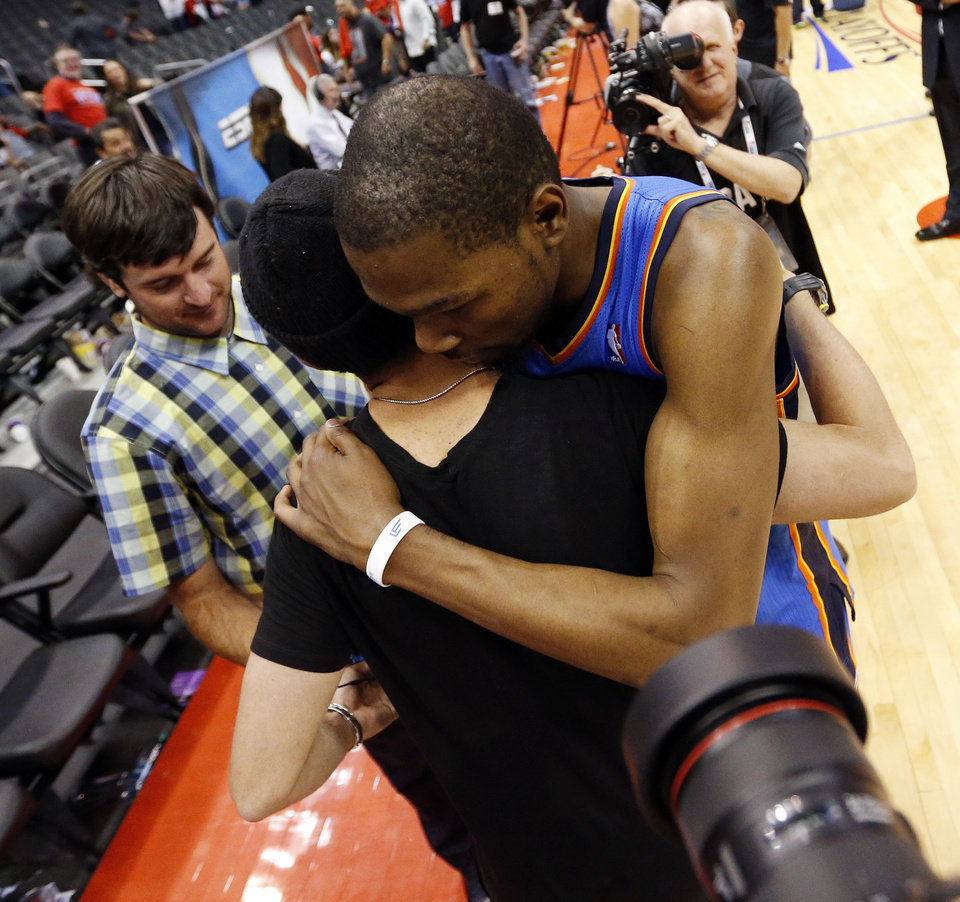 Photo - Oklahoma City's Kevin Durant (35) gets a hug after Game 6 of the Western Conference semifinals in the NBA playoffs between the Oklahoma City Thunder and the Los Angeles Clippers at the Staples Center in Los Angeles, Thursday, May 15, 2014. Photo by Nate Billings, The Oklahoman