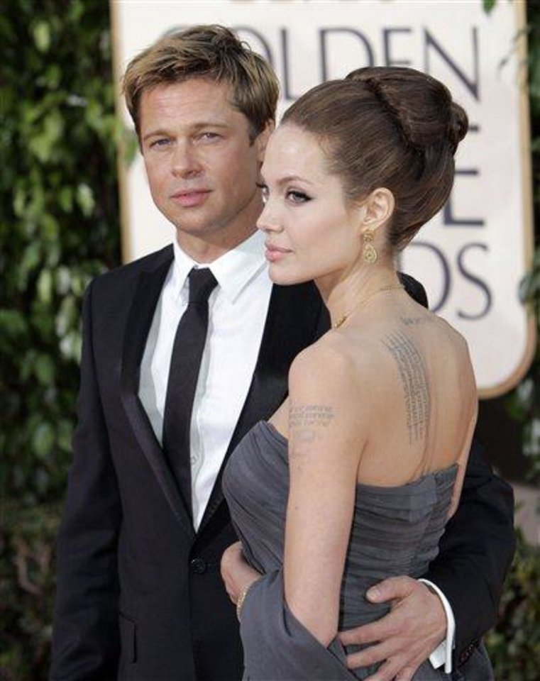 Brad Pitt, left, and Angelina Jolie arrive for the 64th Annual Golden Globe Awards on Monday, Jan. 15, 2007, in Beverly Hills, Calif. (AP Photo/Mark J. Terrill)