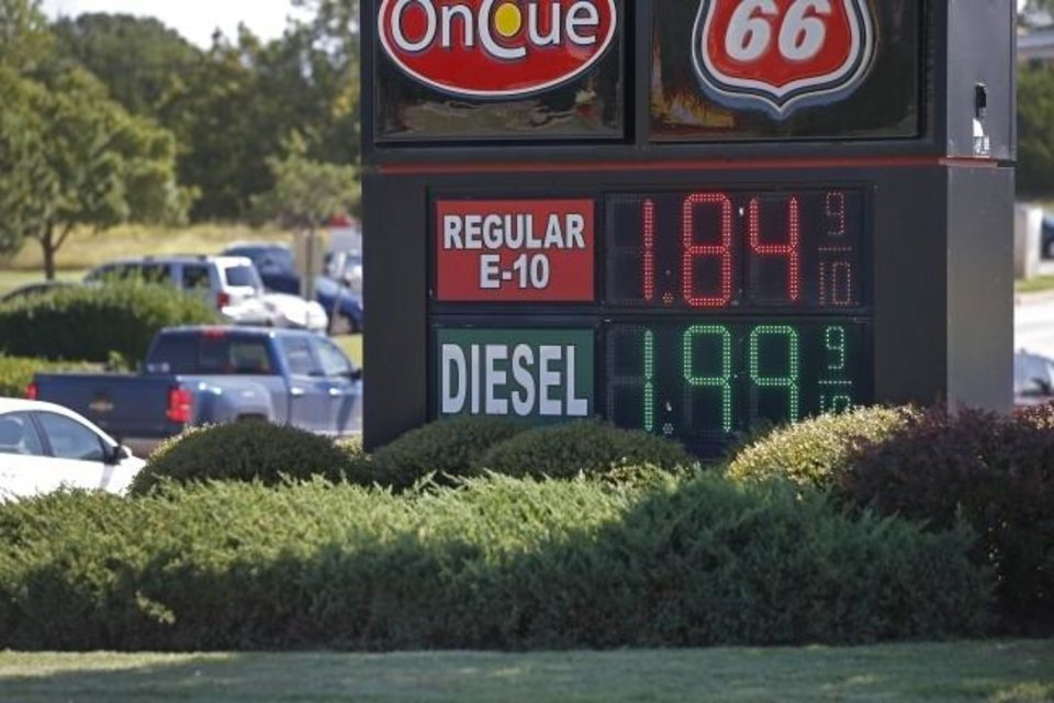 Photo -  Fuel prices for Regular E-10 and diesel are displayed by an Oklahoma City-area retailer earlier this summer. [BRYAN TERRY/THE OKLAHOMAN]