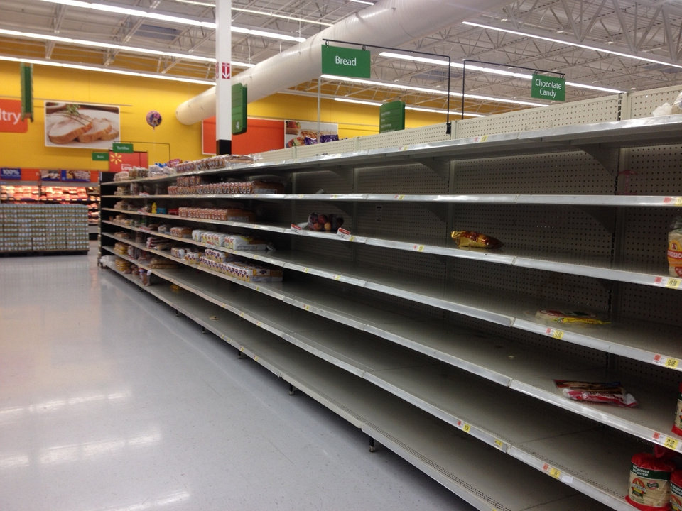 Photo - Shelves emptied before the winter storm at a local Walmart store - Photo by Mike Shannon