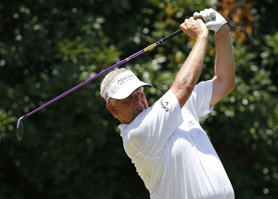Photo - Colin Montgomerie hits off the third tee during the final round of the U.S. Senior Open golf tournament at Oak Tree National in Edmond, Okla., Sunday, July 13, 2014. (AP Photo/Sue Ogrocki)